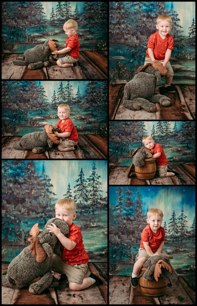 A handsome little boy with a cute moose.